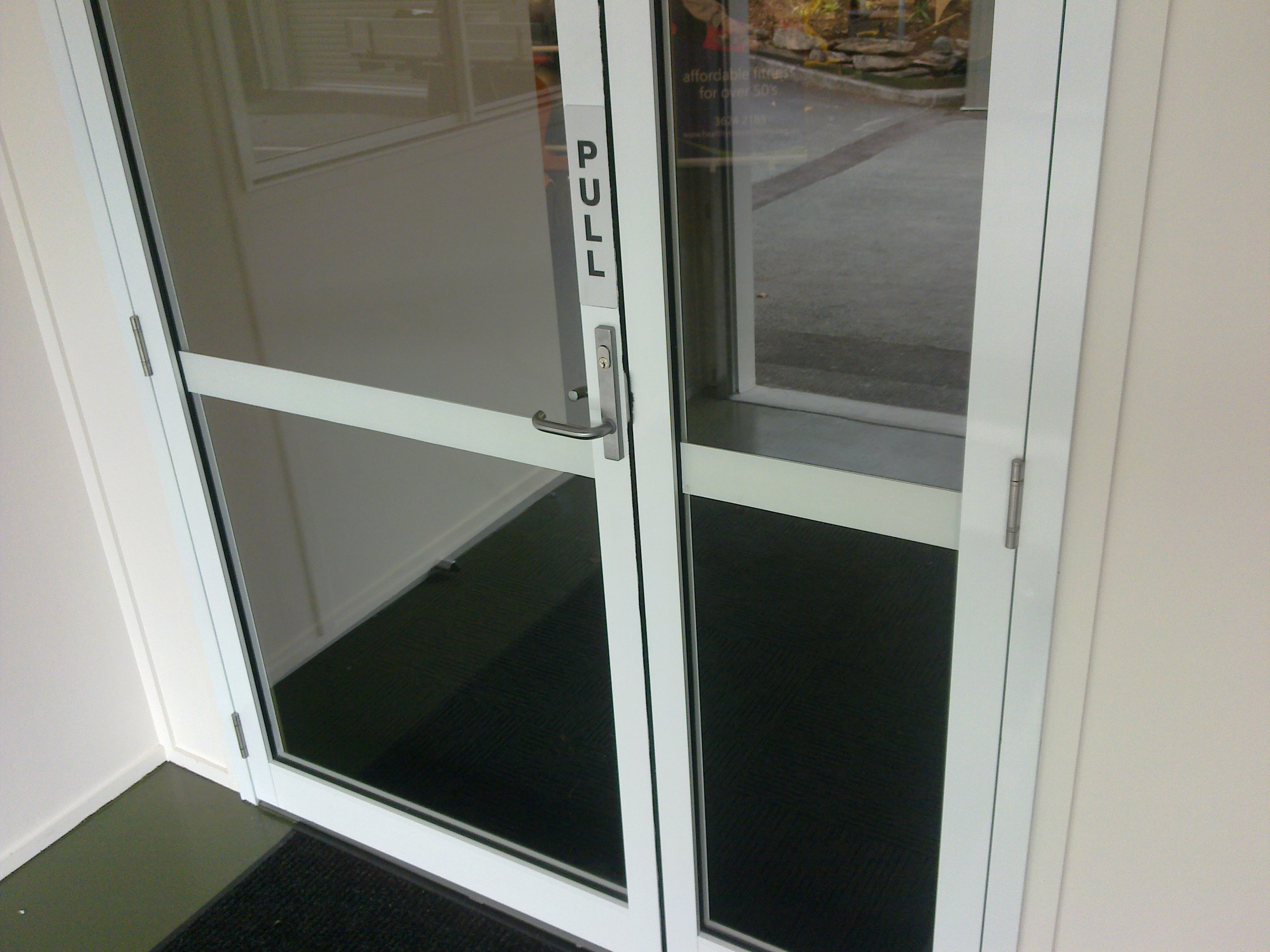 Framed commercial entry door