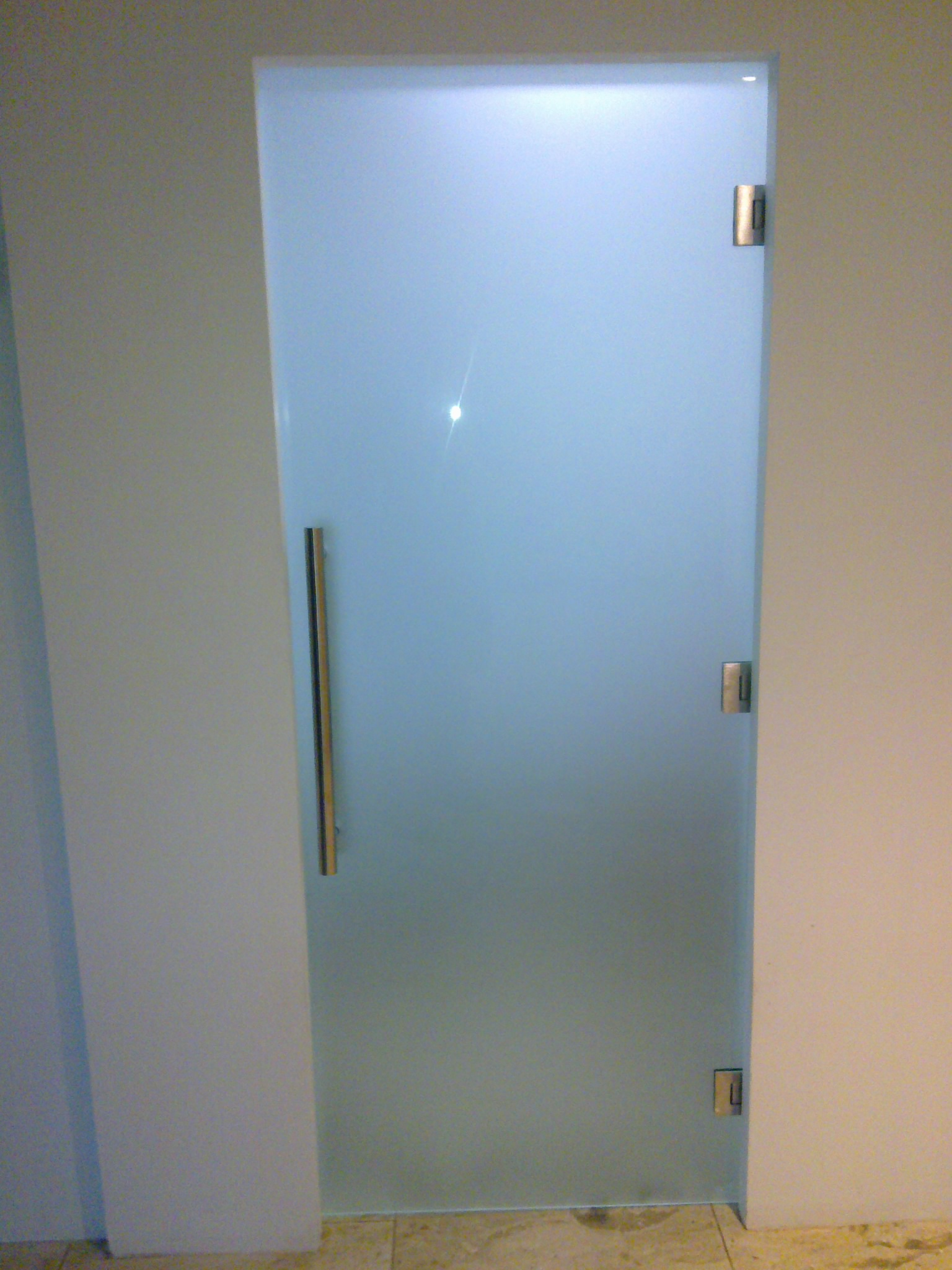 Frameless commercial entry door