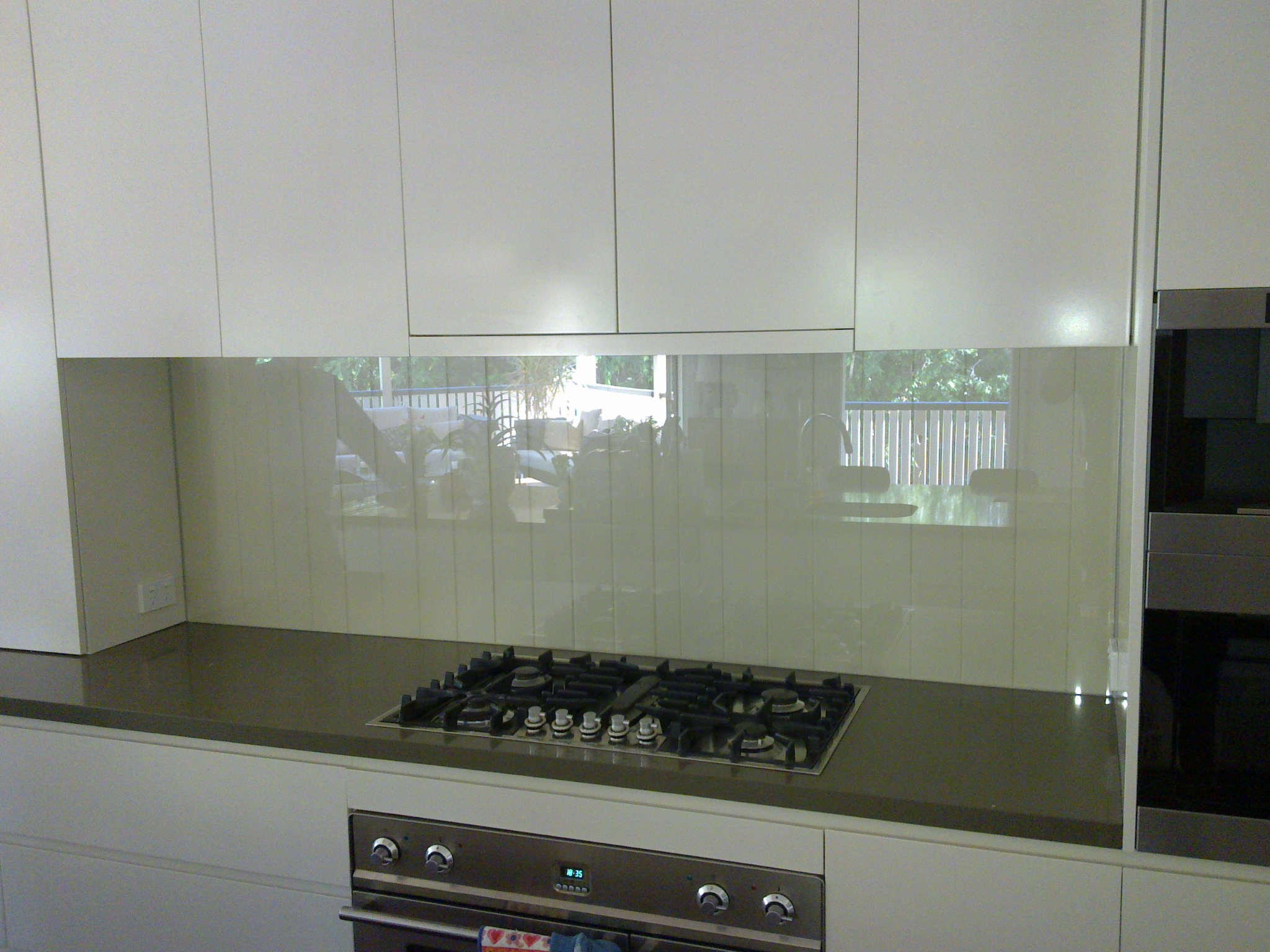 Clear toughened splashback