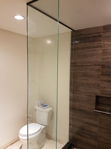 After Remodel  - new frameless glass shower