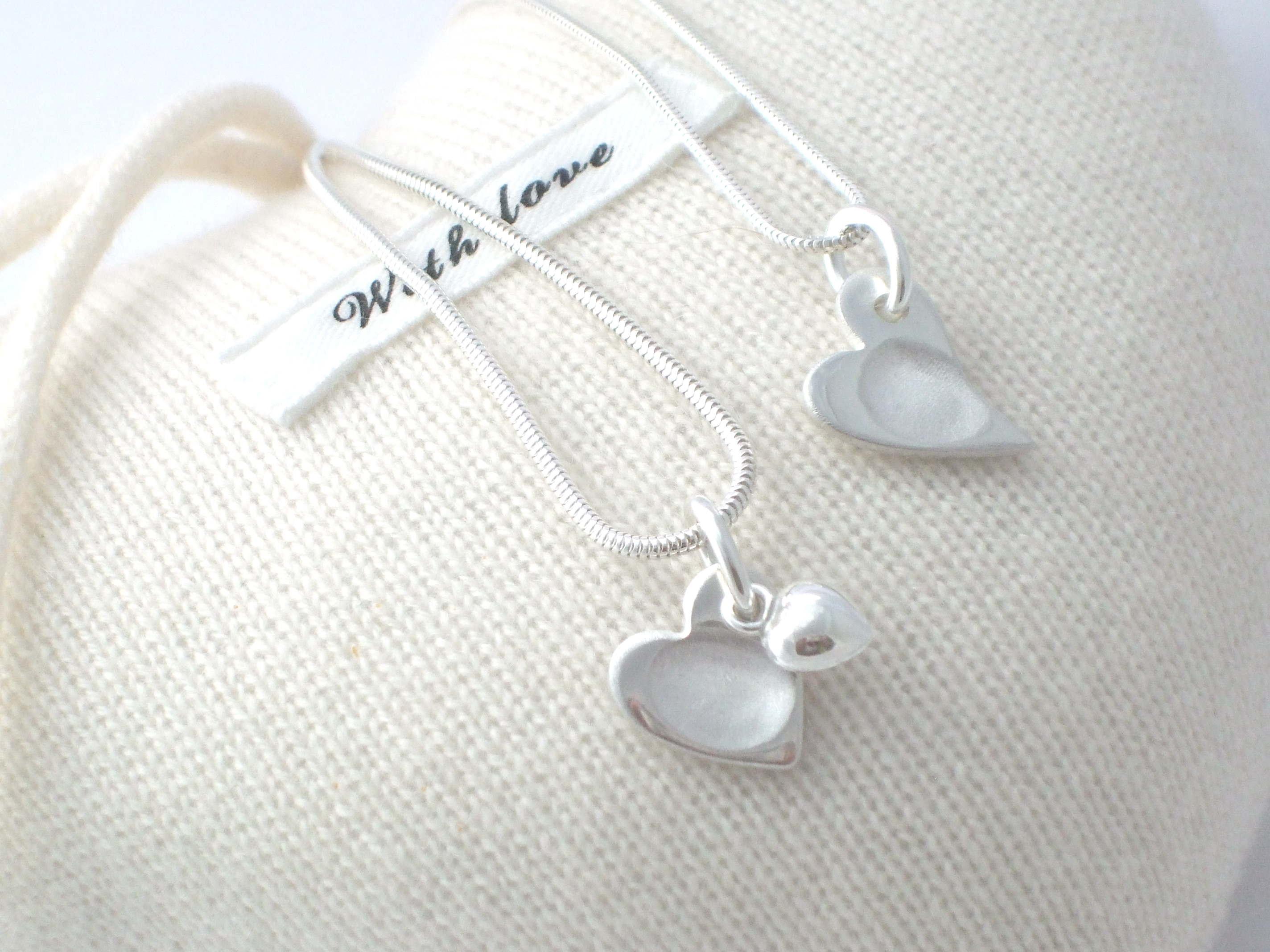 Fingerprint heart charms