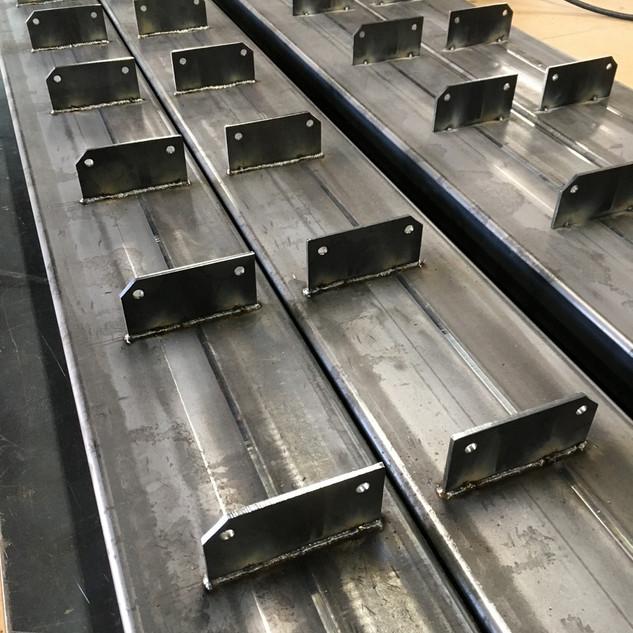 Custom welded rafter fins for pergola canopy