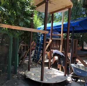 Before: Concrete footings and steel inner posts being set