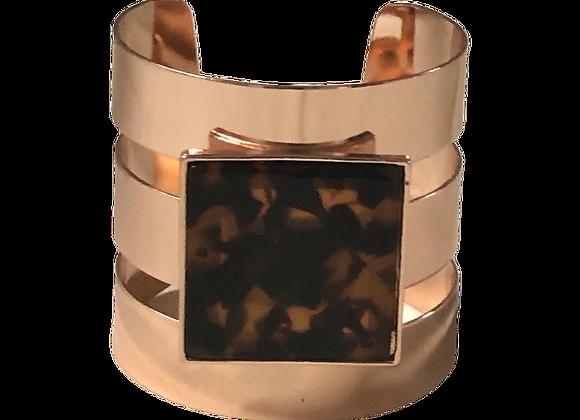 Bracelet de couleur or avec pierre neutre