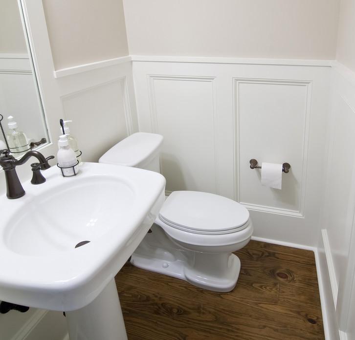 simple elegant white half bathroom with