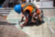 man-wearing-blue-hard-hat-using-hammer-5