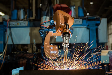Canva - Industrial robot is welding asse