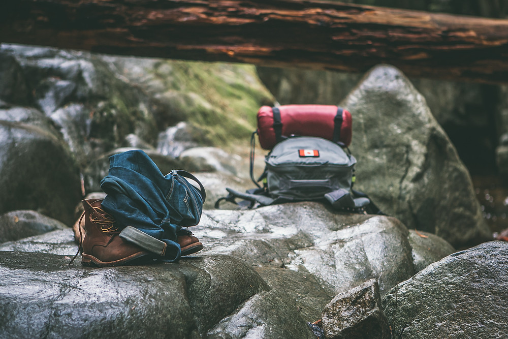 Hikers' backpacks on rocks