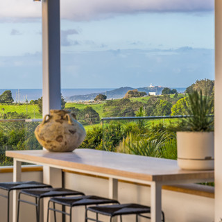 Outdoor seating with hinterland and ocean views