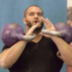 Jordan lifting kettlebells
