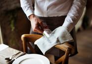 restaurant-staff-setting-table-in-restau
