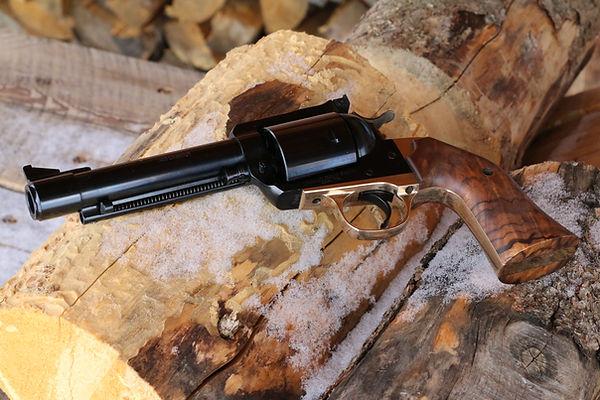 500 caliber pistol, brass grip frame, walnut grips