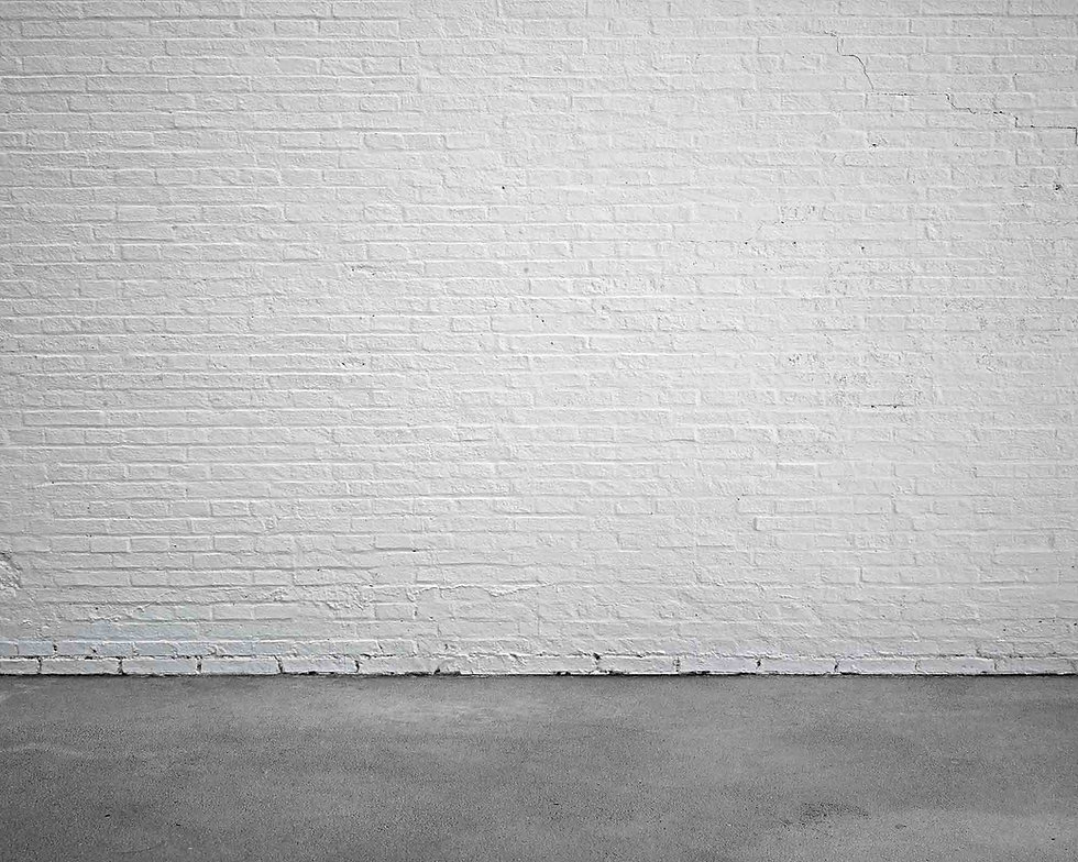 white-stucco-brick-wall-with-cement-floo