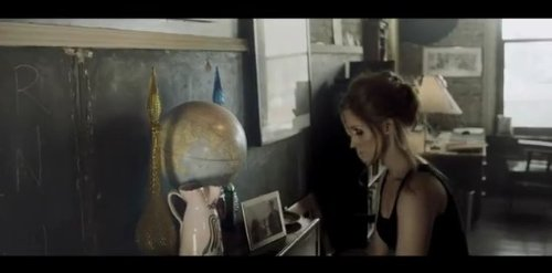"Still from ""Te Dijeron"" music video"