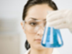 bigstock-Female-scientist-looking-at-be-