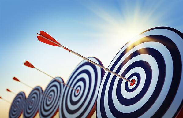target with arrow hitting the bullseye