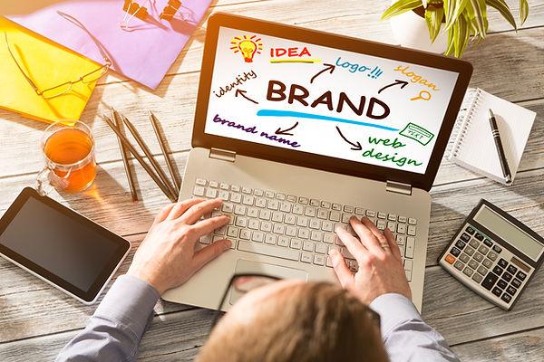 Photo of laptop comuter showing illustration on the screen regarding branding ideas