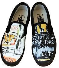 Questo modello di vans nera è decorata nelle punte con i disegni del famoso artista Basquiat, un modo originale per personalizzare delle vans con le opere del tuo artista preferito
