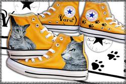 scarpe dipinte con ritratti animali
