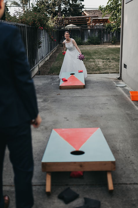 san jose backyard wedding cornhole bride groom