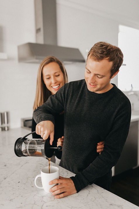 couple pouring french press
