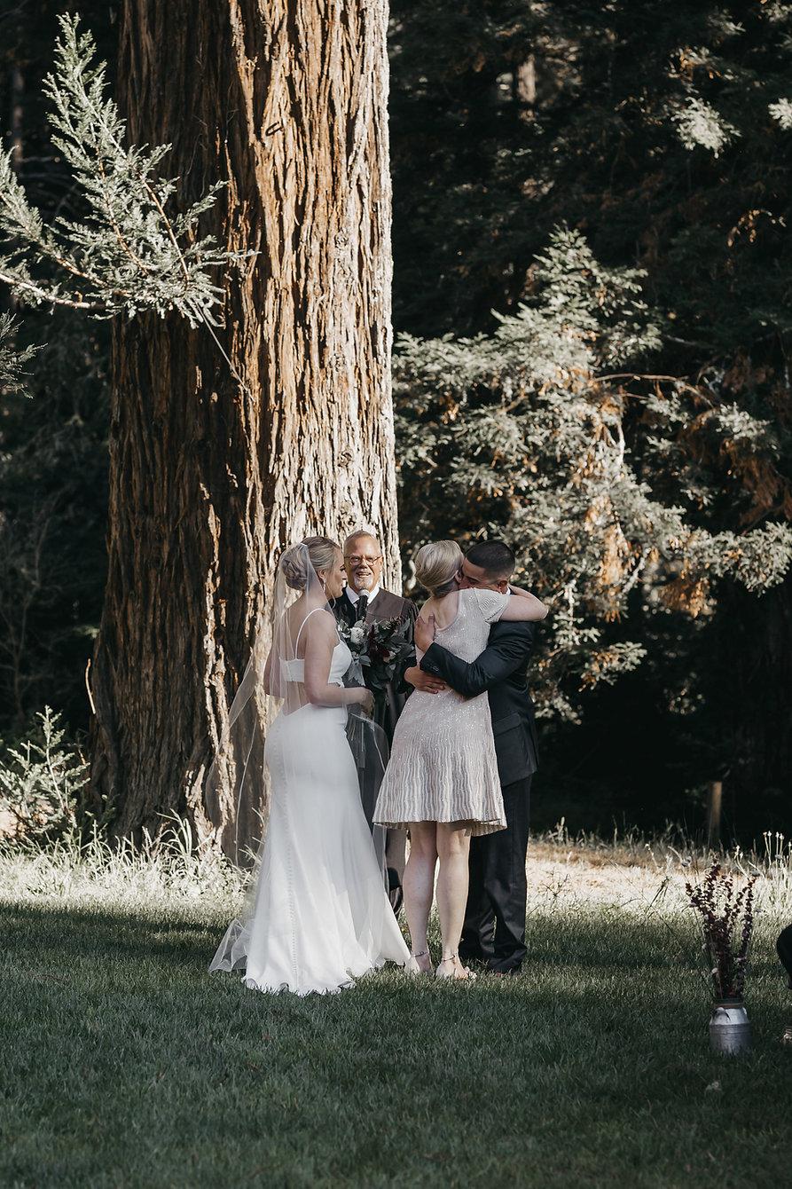 henrik ibsen park redwoods wedding groom hugging brides mom