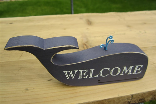 Welcome whale sign