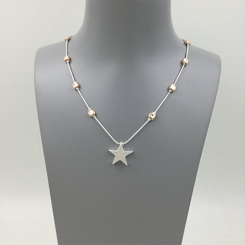 Costume silver star pendant with beaded chain