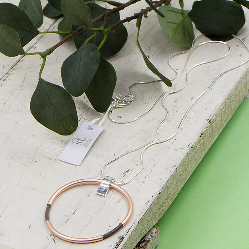 Leather ring pendant on long snake chain necklace