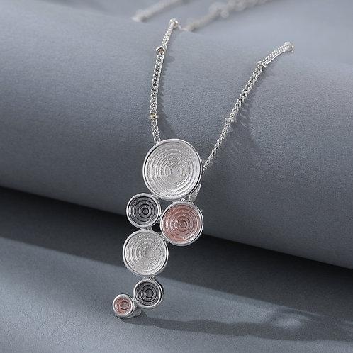 Mixed metals circles textured necklace