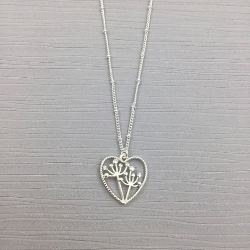 Silver open heart pendant with seed heads