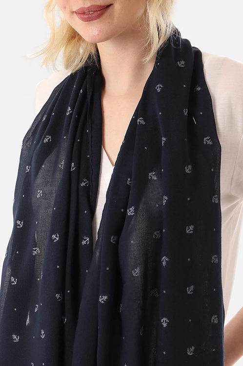 A navy blue scarf with a copper stag print
