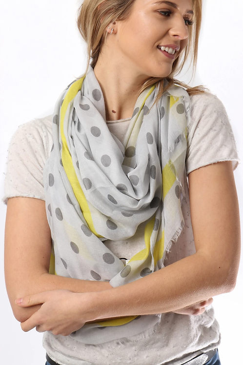A grey scarf with a spot print and yellow border