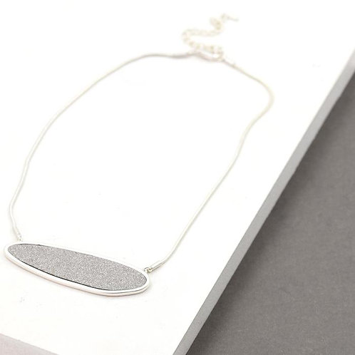 Organic shaped pendant on short snake chain necklace