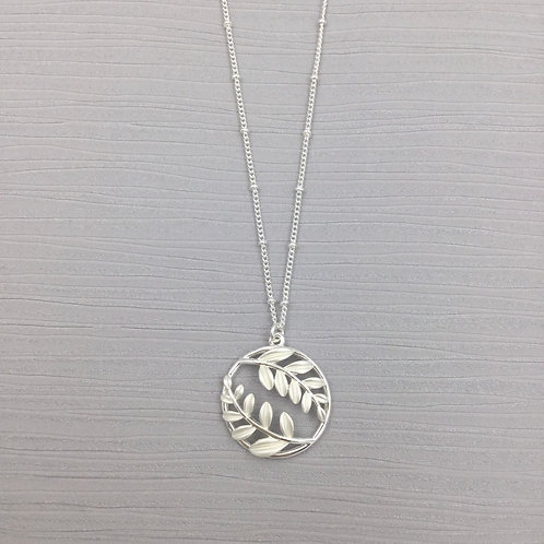 Silver Costume Circle Pendant with Leaves