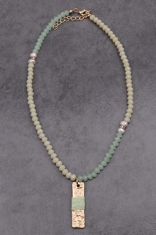 green & cream beaded necklace with hanging green & gold pendant