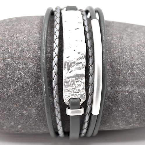 Multi strand bracelet with hammered metal section