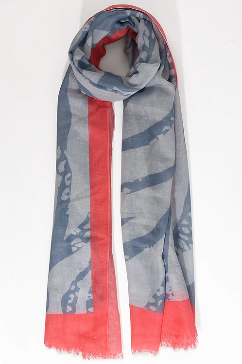 A dark grey zebra print scarf with a contrast coral trim