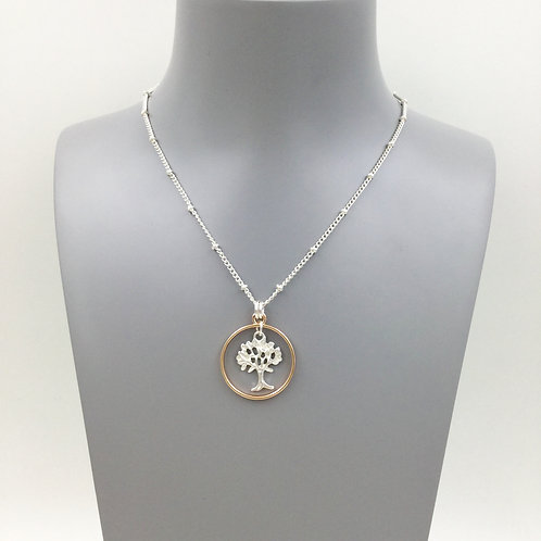 Tree of life circle pendant in gold and silver