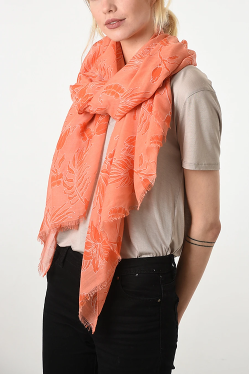 A lightweight coral and pink tropical florals scarf