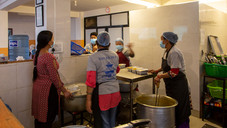 In the kitchen of the Spanish NGO Hugging Nepal, cooks prepare more than 300 food packs every morning.