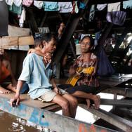 Manggarai. Families live above the canal