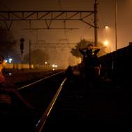 Jatinegara, along the rail way, behind the wall...