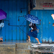 Pluit. Young schoolgirls under the rain