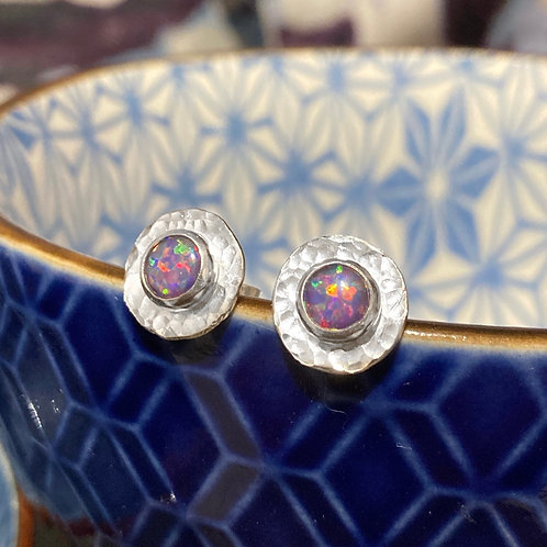 Silver hammered stud earrings with pink/purple created opals
