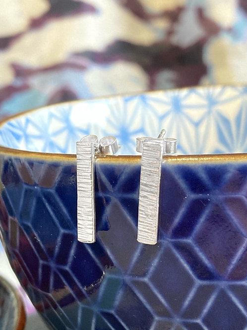 Silver textured stud earrings