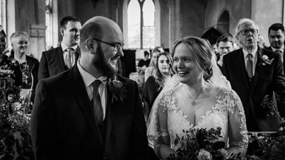 Bride and Groom look at each other at St Pauls Church Thuxton