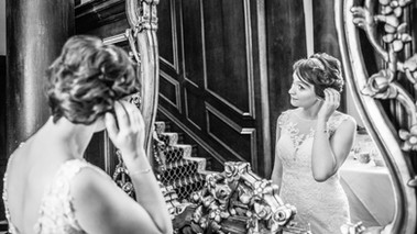 Bride looking in the mirror at St Giles House
