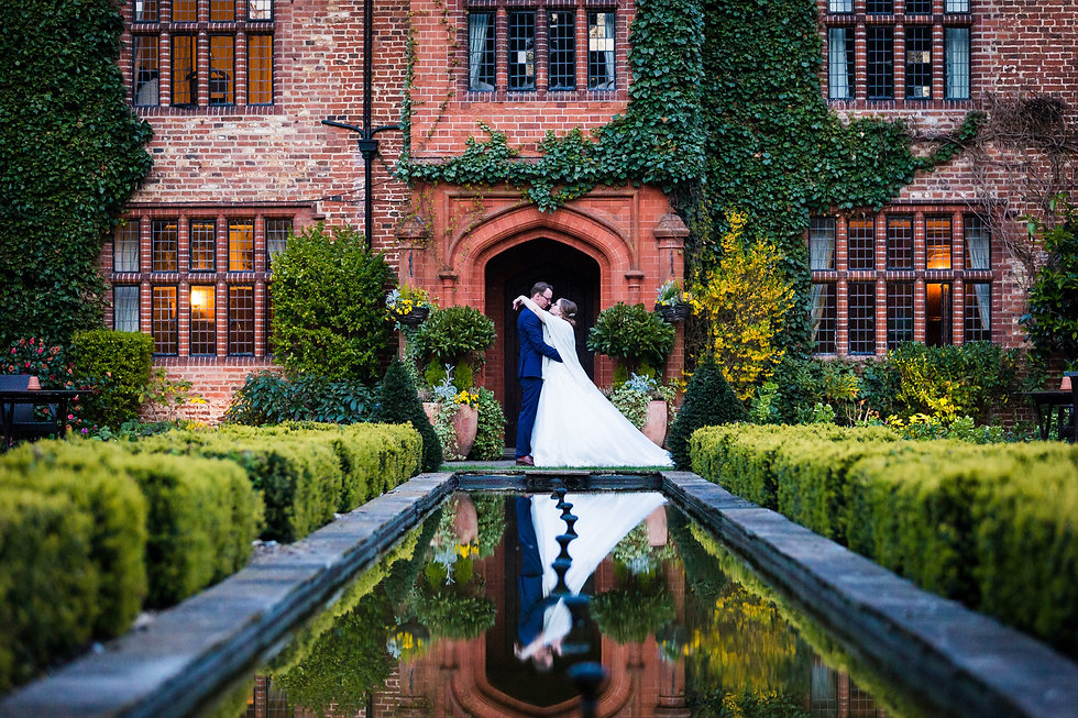 Bride and Groom at Woodhall Manor romantic pose