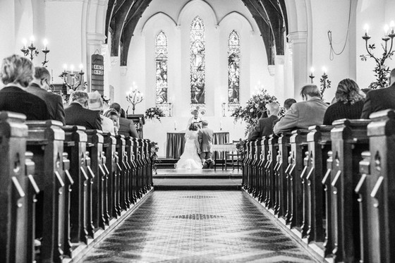 Bride and groom getting married at All Saints Chruch North Wooton